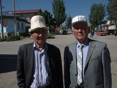Old men showcasing Kyrgyz hats made of felt; Karakol