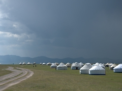 Yurts dot the shoreline of Lake Son-Kul