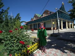 Becky dressed in borrowed garb to visit Karakol's Chinese Mosque