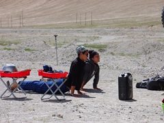 Becky and Ichi doing a bit of yoga at our bushcamp; Karakoram Highway