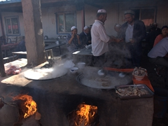 Preparing lunch; Kashgar Sunday Market