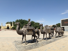 Camel caravan in front of  Id Kah Mosque. Kashgar is well entrenched on the Silk Road as indicated by this monument