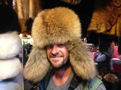 Robby models a fur hat; Kashgar bazaar