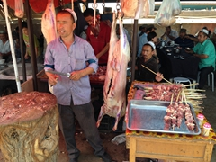 A butcher sharpens his knife