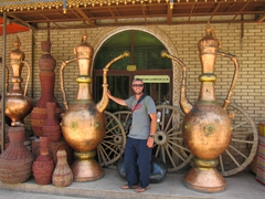 Robby between two massive brass pots; Kashgar