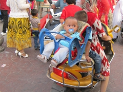 Rear facing baby chair strapped onto a scooter! We saw 5 on a bike here in Kashgar