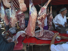 Butchers conduct brisk business at the Kashgar Sunday Market