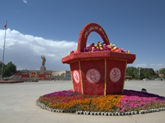 Massive flower display with Mao in the background; Kashgar People's Square