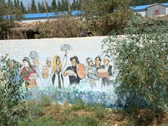 Many of the houses near the Karez Irrigation Channel are decorated with colorful murals such as this one