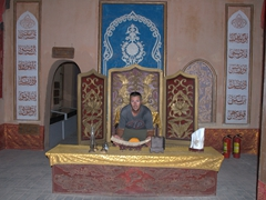Robby cradles a carved ivory tusk; Turpan Mansion