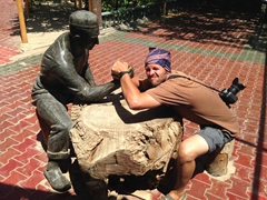 Robby in an arm wrestle pose; Karez