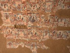 Destroyed frescoes at Bezeklik Thousand Buddha Cave complex