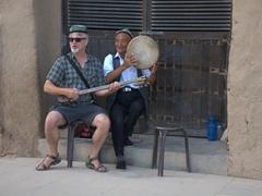 Kevin provides some impromptu entertainment; Bezeklik Thousand Buddha Cave complex