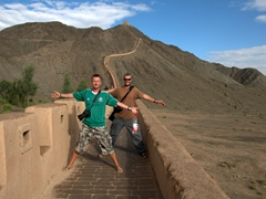 Lars and Robby strike a pose on the Great Wall of China; Jiayuguan