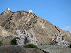 Statues at the base of the Great Wall of China; Jiayuguan