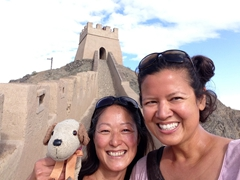 Ichi and Becky smile after making it to the top of the fort at Jiayuguan, the westernmost section of the Great Wall of China