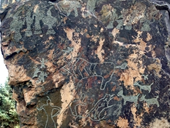 Rock carvings found on the cliffs of the Heishan Gorge on display at Jiayuguan