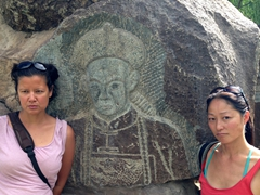 Becky and Ichi mimic a rock carving; Jiayuguan