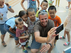 Robby making new friends; Dunhuang