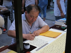 Calligrapher at Dunhuang's night market