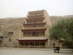 The largest Buddha statue (34.5 meters or 113 feet tall) is housed behind this edifice; Mogao Caves