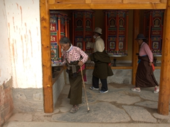 Spinning prayer wheels at Labrang Monastery