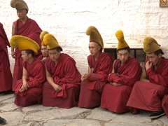 Monks gathering for the daily 11:30 am prayer session; Labrang Monastery