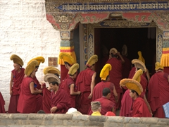 Monks heading in for morning prayers; Labrang Monastery