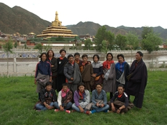 Buddhist pilgrims taking a group photo at Labrang Monastery