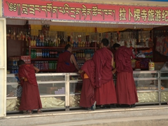 Monks shopping for souvenirs; Labrang Monastery