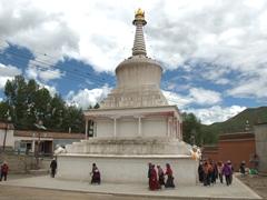 Pilgrims circling a stupa; Xiahe