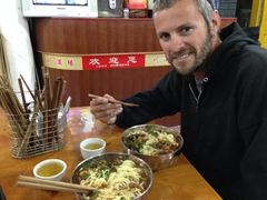 Robby about to chow down on his yak meat soup; Chuanzhusi