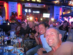 Doris, Adam, Lars, Ichi, Becky and Robby split a whopping 45 bottles of Tiger Beer while watching the Chengdu Music Festival