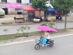 Scooter umbrellas...a perfect Chinese invention!
