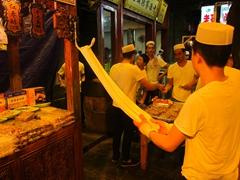 Kneading a desert treat at Xi'an night market; Muslim Quarter
