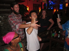Kyle forcing Tom (our Chinese guide) to drink some rice wine; Marley's Bar in Xi'an