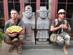 Robby and Lars mimic statues at a Korean restaurant; Xi'an