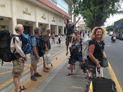 Robby photobombs the group leaving for Beijing (Chris, Kevin, Warner, Kate, young Kate and SCUBA Gill); Xi'an