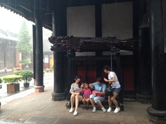 Locals seeking refuge from the torrential rain storm that hit suddenly; Wenshu Yuan Monastery