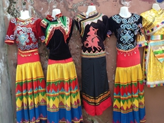 Colorful ethnic dresses for sale; Xichang