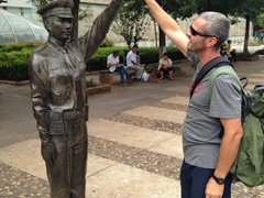 Robby high-fiving a statue in Kunming