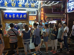 Locals lining up at this popular eatery; Xi'an night market
