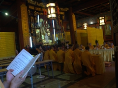 Buddhist monks chanting and praying at Wenshu Yuan Monastery; Chengdu