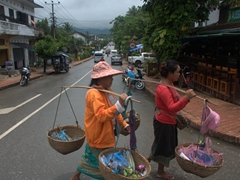 Female vendors crossing the street in Luang Prabang