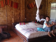 Becky relaxing in our room at Phou Lu III Bungalows; Luang Namtha