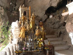 Buddha statues inside the lower cave; Pak Ou Caves