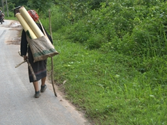 A lady carrying supplies back to her mountain village