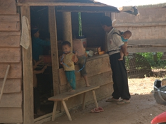 We were surprised to see so many men caring for their children in Laos - a role normally reserved for women in most of the world