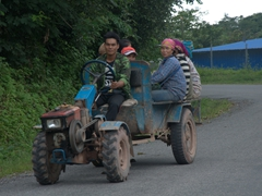Locals hitching a ride on a tractor
