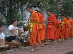 Early each morning (around 5:45 am), the monks of Luang Prabang line up to receive food donations